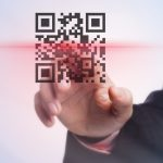 Businessman scanning a virtual screen with QR code