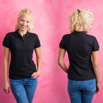 Woman in black polo T-shirt on pink background. Corporate apparel