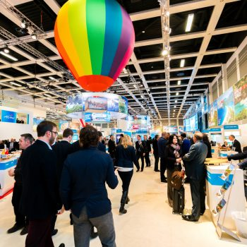 Various exhibitor booths seen during the ITB Berlin 2016, one of Germany's biggest travel fairs held in Messe Berlin in Berlin, Germany. Visitors can be seen walking around the aisles.